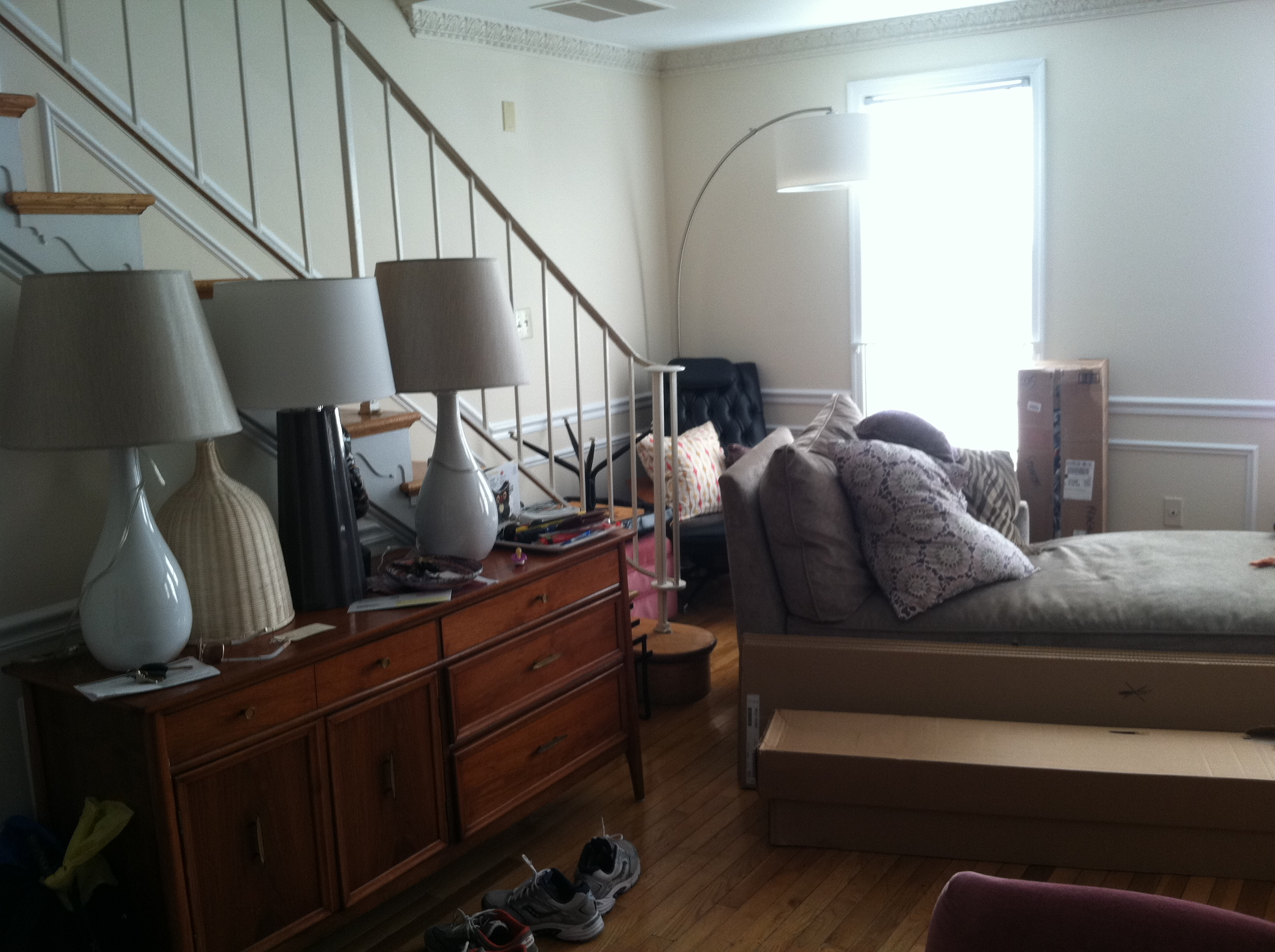 messy apartment room. apartment envy interior design decorating moving messy furniture too big  living room fireplace marble hardwood floors Messy Staircase Apartment Envy