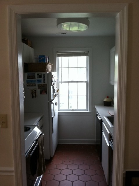apartment kitchen condo before and after makeover chalkboard paint black walls tiny small update DIY red tile spanish tile