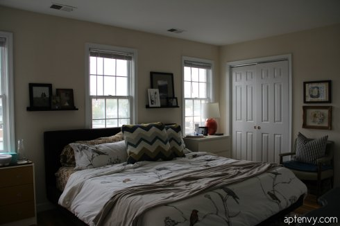 small apartment condo bedroom before and after makeover dwell studio chinoiserie duvet vintage mid-century chairs photo ledges ikea overstock retro upholstered bed