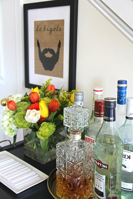 vintage bar cart styled with flowers and bottles